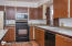 Laminate Flooring, new paint, marble counter tops, tile work