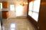 Dining area has newer laminate flooring. Door goes to back deck and backyard.