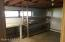 Downstairs room, unfinished, was used as workshop. Could be finished and used as a bedroom.