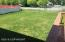 Backyard is completely covered with lawn. Fully fenced. Street behind is Fireweed which deadends to your right.