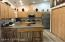 Spacious kitchen with an abundance of cabinets and counter space, stainless steel high end appliances, and huge pantry...