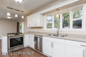 Beautiful stainless steel appliances and bay window