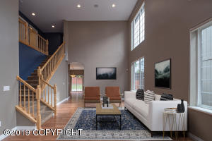 Talk about a breathtaking entrance. This two story great room is stunning. A must see in person space to appreciate the space.