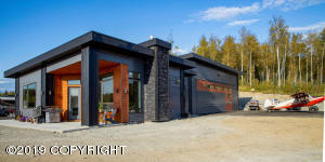 This home is located in same airpark by Last Frontier Contracting on Preflight Way