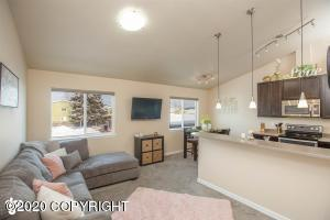 Vaulted ceilings and open concept living/dining and kitchen