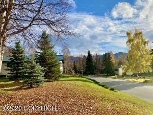 Positioned on a sunny knoll in an established east side neighborhood w/mountain views