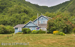 Classic 5 BR/4BA Home in Lush Canyon Setting with 6-Stall Horse Barn and Cabin/Studio