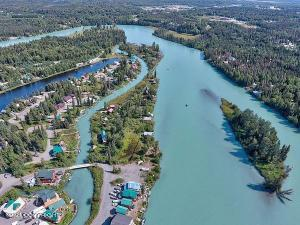 4 lots for sale in Castaway Cove on the Kenai River, one with a cabin