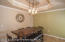 Dining area is tiled & large enough for hutch & 6 seat table. Recessed ceiling & modern lighting.