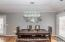 Designer chandelier and room for a large table in this dining area!