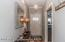 Welcoming entry with designer lighting.