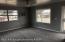 Living room with fresh paint & new ceramic flooring.