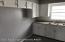 Kitchen with fresh paint & new ceramic flooring.