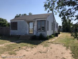 Newer roof, faded metal siding, newer windows…