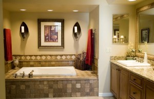 Roomy Master Bath with Jacizzi, larger walk-in separate shower, dual sinks and custom tile work.