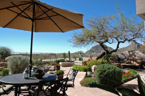 Sunsets are magnificent from this home. Views of Pinnacle Peak and the city lights are fantastic as well. The beautifully maintained yard has a water feature with a stream.