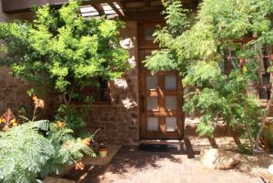 The lush landscaping and Tuscan styling make this courtyard entry very inviting