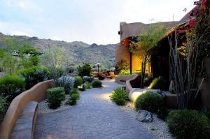 Pavered walkway leads to intimate courtyard.