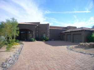 Beautiful cobblestone driveway leads the way to home!