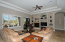 Dual sets of double french doors open to large coverd patio. Great Room with lighted niches to display your treasures.