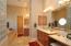Glass Block & His/Her vanities. Garden Tub with jets Wonderful walk - in closet custom designed
