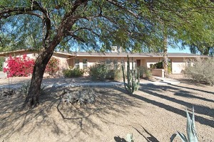 You'll find lots of space both inside and out at this ranch style home that welcomes you with a big front yard, vibrant red bougainvillea, lacy shade trees and mountain views.