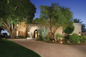 A circular drive leads to this 10,957sf estate on a private one acre homesite with views.