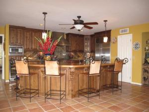 WITH GORGEOUS KNOTTY ALDER CABINETRY