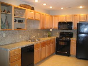 New Cabinets with Hardware. Tile Granite Counter & Backsplash.