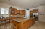 Granite counters, plenty of cabinets and storage areas. Large pantry. Desk area. Island with sink.