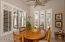 Sunny and cheerful breakfast room looks east to Troon Mountain and to patio and pool.