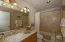 Guest bath serves the 2 guest bedrooms. Granite counters.
