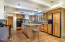 MODERNIZED KITCHEN HAS BEAUTIFUL ALDER CABINETS, TOP GRANITE COUNTERS AND TOP OF THE LINE APPLIANCES