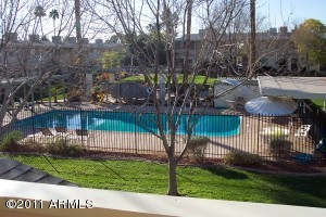VIEW OF BEAUTIFUL SPARKLING POOL & GREENBELT FROM LIVING RM, KITCHEN & MASTER BEDROOM TOO!