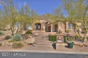 Welcome home to this fabulous, hillside, Mediterranean villa. Unparalleled custom finishes abound, including Venetian plaster walls and ceilings, hand painted murals, interior and exterior stone walls and massive carved stone fireplaces. Beautifully bricked circular drive and formal entry with detailed marble medallion and rich iron balcony and stair rail. Private rear gate to motor court. This is the only home in Ancala with entrances on two streets. All of main living is on one level with additional suite, kitchen, gameroom, and secondary family on lower level. Main level includes luxurious master suite, 3 smaller suites, kitchen, family room, formal living, separate formal dining, and well appointed office with rich wood cabinetry and hand painted mural. This is truly a one of a kind home!