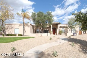 This home has it all. Almost an ACRE with beautifully manicured yards and stunning interiors that include an open floor plan, vaulted ceiling, lots of tile, neutral colors, clerestory windows, plant shelves and custom built-ins.