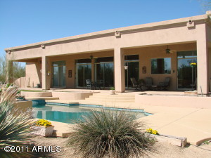 Covered Patio goes the length of the home - great for entertaining, relaxing and enjoying the mountain views.
