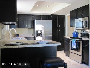 Kitchen has all new appliances and granite counters with a breakfast bar