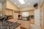 Granite Slab Counter tops and tumbled stone backsplash