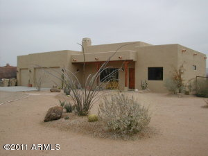 Great desert curb appeal. Circle drive and 3 car garage.