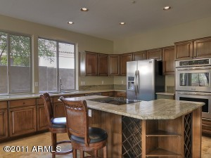 New Stainless Sink, disposal, Counter Depth Refrigerator with Water and Ice in the Door, Double Ovens, Faucet with pull out, island cook top...light flows through walls of glass