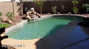 Large pebble tec pool with rock waterfall