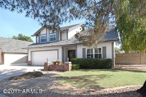 Combining casual Arizona living with a sense of style this updated home welcomes you with a tiled entry, vaulted ceilings, French exits, plantation shutters, soft arched passageways and beautiful laminated wood flooring.
