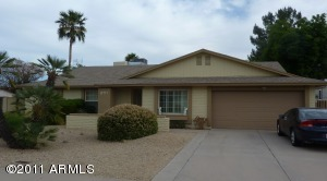 Well maintained desert landscaping in front yard. RV Gates on both sides of home!