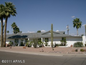 Home on corner lot plus a half lot more with low maintenance desert landscaping.