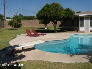 Relax poolside in your spacious back yard!