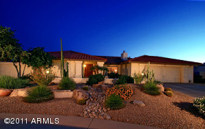Classic Scottsdale Ranch Design Accented with Lush Desert Landscaping, Water Feature and Pavers
