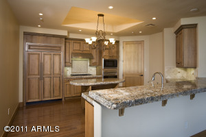 Beautiful warm tones with carmel brown granite counters and toffee alder cabinets