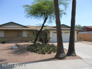 Front of home has desert landscaping