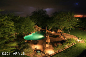 Relax and play in this resort-inspired pebble-type pool & spa with lots of surrounding green grass and room to dream.
